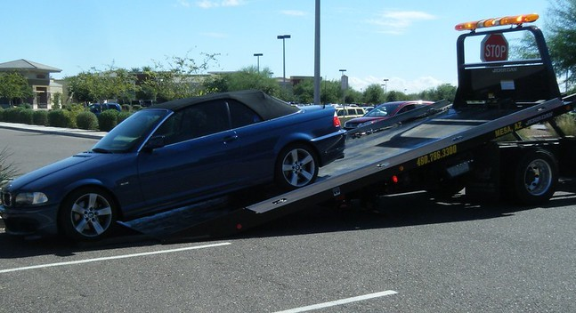 BMW towed on flat bed truck